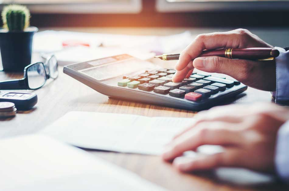 First-time homebuyer using a calculator to evaluate their finances
