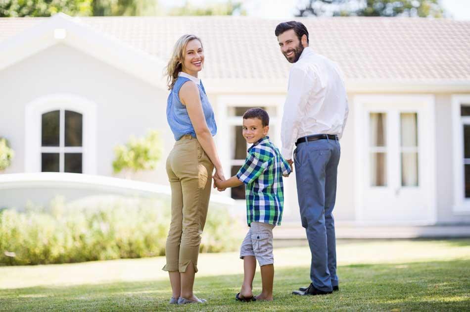 A family stands in front of a home trying to choose which type of home loan to get