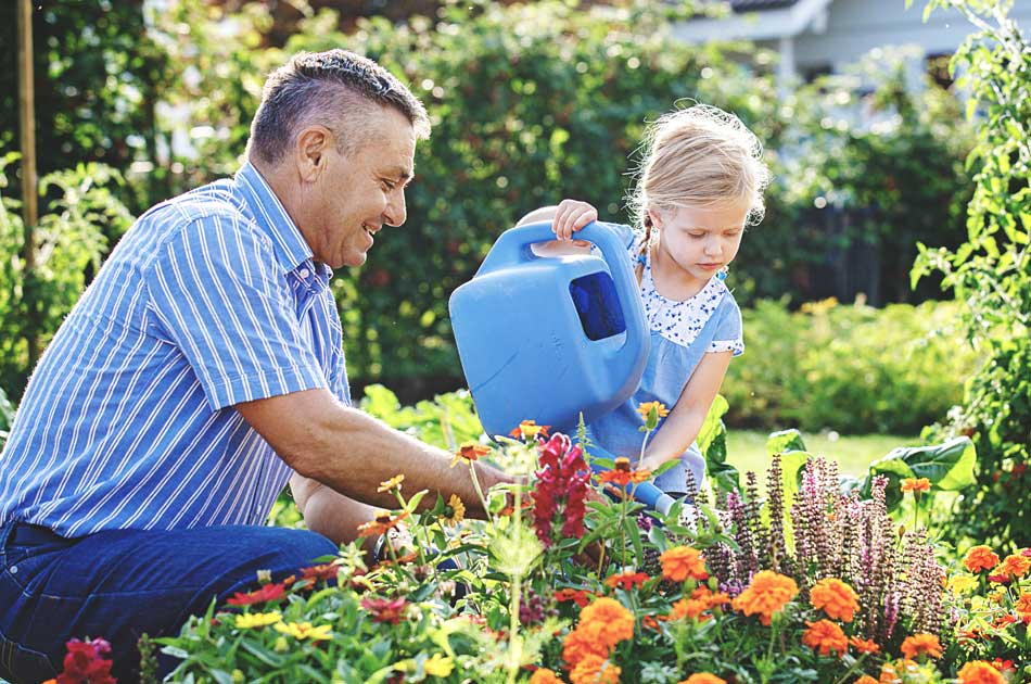 A father & daughter plant flowers to improve their home's appeal before a mortgage refinance